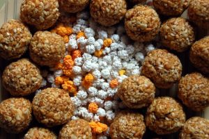 Haldi kum-kum on Sankranti- Picture of 'til-gul' and sweets