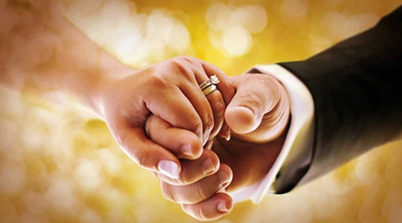 Image of couple holding hands in marriage